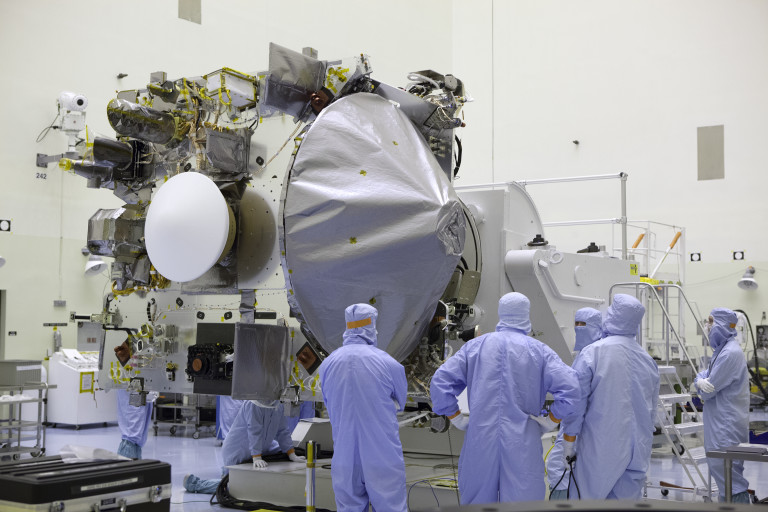 OSIRIS-REx being hoisted on a rotation stand and rotated downwards inside the PHSF. Image Credit: NASA/ Dimitri Gerondidakis