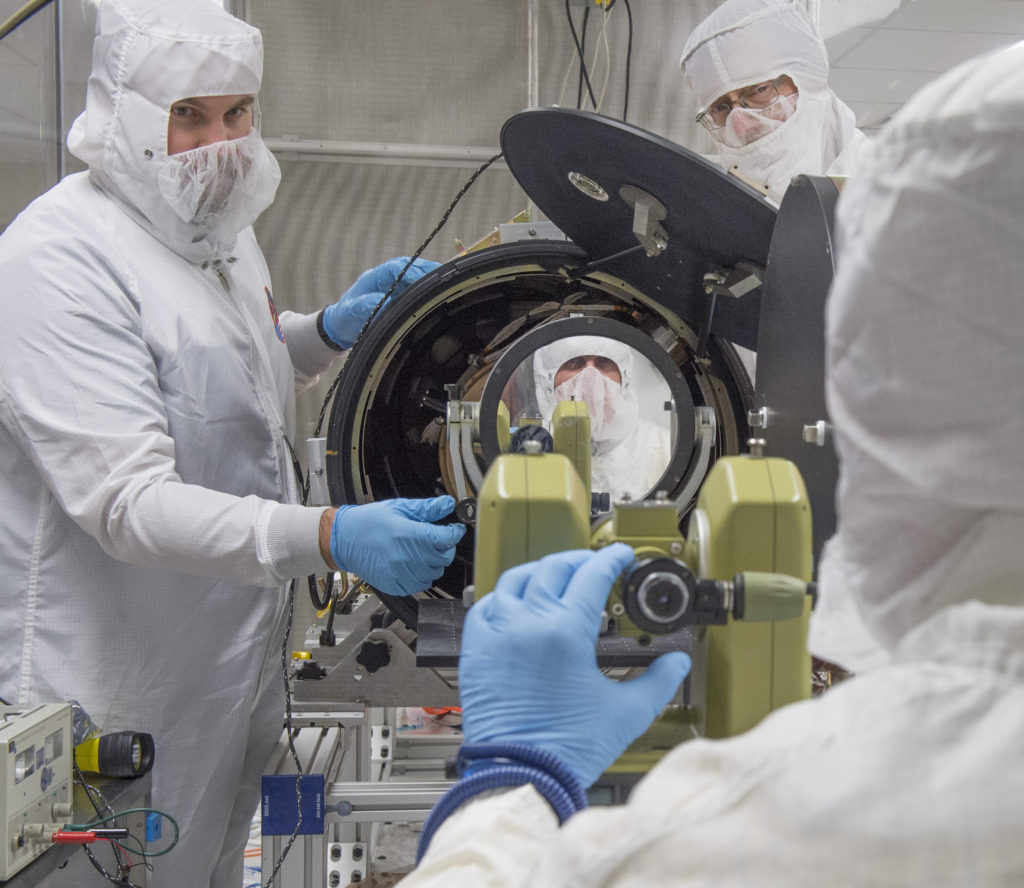 Patrick Champey (University of Alabama – Huntsville graduate student), Richard Gates and William Podgorski (Smithsonian Astrophysical Observatory) complete an alignment procedure on the Hi-C instrument in a clean room at the National Space Science Technology Center in Huntsville, Alabama, prior to shipping to White Sands Missile Range in New Mexico for its July 19, 2016, launch. Image Credit: NASA/MSFC/Emmett Given