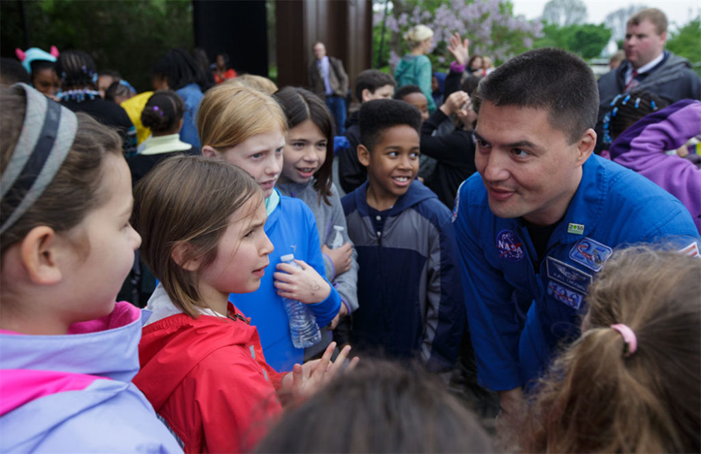 NASA astronaut Kjell Lindgren inspires D.C.-area students on April 27 at the Sylvan Theater on the National Mall in Washington, D.C. Lindgren spent 141 days aboard the International Space Station as part of Expeditions 44 and 45. Image Credit: NASA/Joel Kowsky