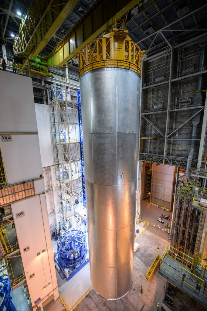 Space Launch System LH2 Qualification tank moves from the Vertical Assembly Center after welds have been completed to a holding cell untill it will be laid on its side. Image credit: NASA/Michoud/Eric Bordelon