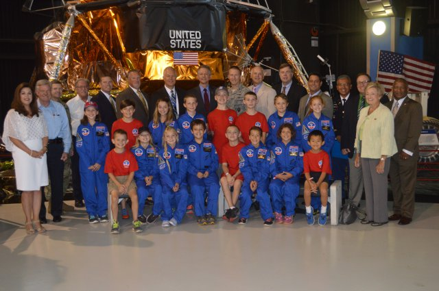 Members of the Air, Space, and Missile Defense Association pose with the 16 recipients of the 2016 ASMDA Space Camp scholarship at the U.S. Space and Rocket Center in Huntsville, Alabama, July 6. Since 1996, ASMDA has sent more than 200 students to Space Camp. Image Credit: Jason B. Cutshaw