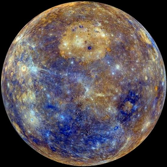 Enhanced color image of Mercury. The bright, circular deposit in the upper center of the image is an enormous effusive volcanic deposit, situated within the largest impact crater on the planet, the Caloris basin. Image Credit: NASA/Johns Hopkins Applied Physics Lab/Carnegie Institution of Washington