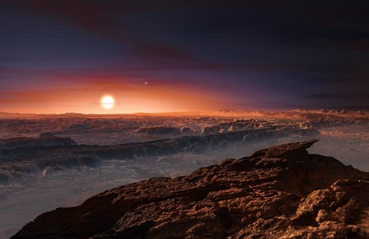This artist's impression shows a view of the surface of the planet Proxima b orbiting the red dwarf star Proxima Centauri, the closest star to the Solar System. The double star Alpha Centauri AB also appears in the image to the upper-right of Proxima itself. Proxima b is a little more massive than the Earth and orbits in the habitable zone around Proxima Centauri, where the temperature is suitable for liquid water to exist on its surface. Image Credit: ESO/M. Kornmesser
