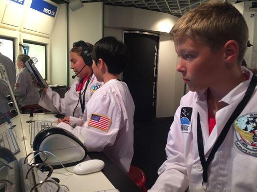 Students participating in the STEM Camp participate in a field trip to Challenger Learning Center for the Voyage to Mars simulation in Colorado Springs, Colo., Aug. 3, 2016. The camp taught the value of design thinking, building confidence with technology through problem solving and individual learning experiences. Image Credit: USAF