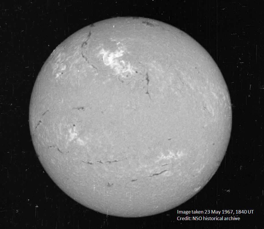 A view of the Sun on May 23, 1967, in a narrow visible wavelength of light called Hydrogen-alpha. The bright region in the top center region of brightness shows the area where the large flare occurred. Image Credit: National Solar Observatory historical archive