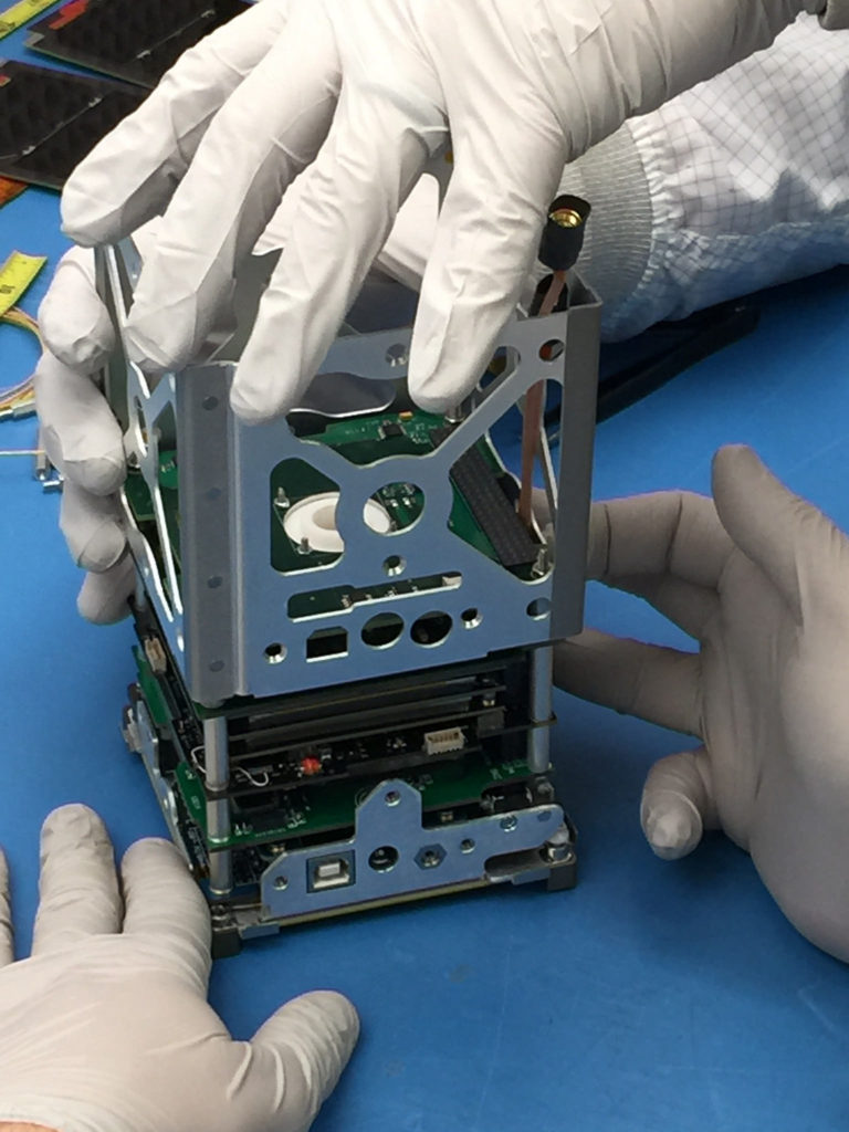 The BisonSat is one example of a CubeSat mission launched by NASA's CubeSat Launch Initiative on Oct. 8, 2015. The BisonSat is an Earth science mission that will demonstrate the acquisition of 100-meter or better resolution visible light imagery of Earth using passive magnetic stabilization from a CubeSat. The science data, 69-by-52 kilometer color images with a resolution of 43 meters per pixel, a few of which will be images of the Flathead Indian Reservation in northwest Montana, will be used primarily for engaging tribal college students and tribal communities in NASA's mission. BisonSat is the first CubeSat designed, built, tested, and operated by tribal college students. Image Credit: Salish Kootenai College