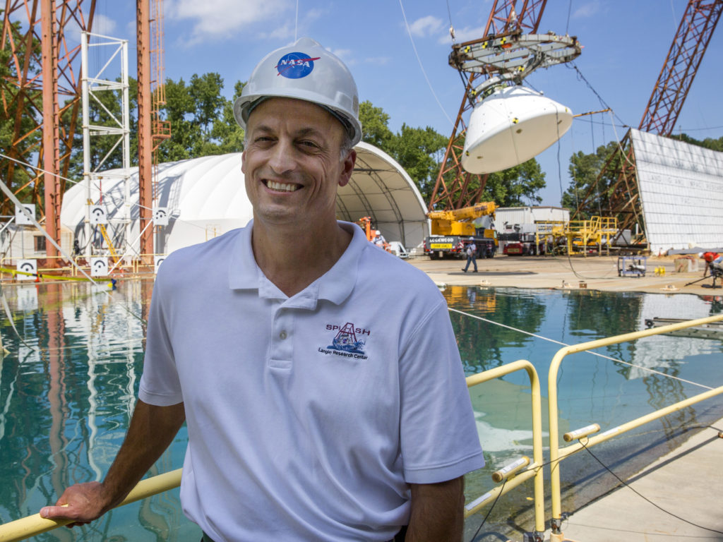 Jim Corliss, project chief engineer, poses moments before the Aug. 25, 2016 drop test. Corliss explained that forces absorbed during splashdown determine more than half of the structure of the crew module. Image Credit: NASA/David C. Bowman