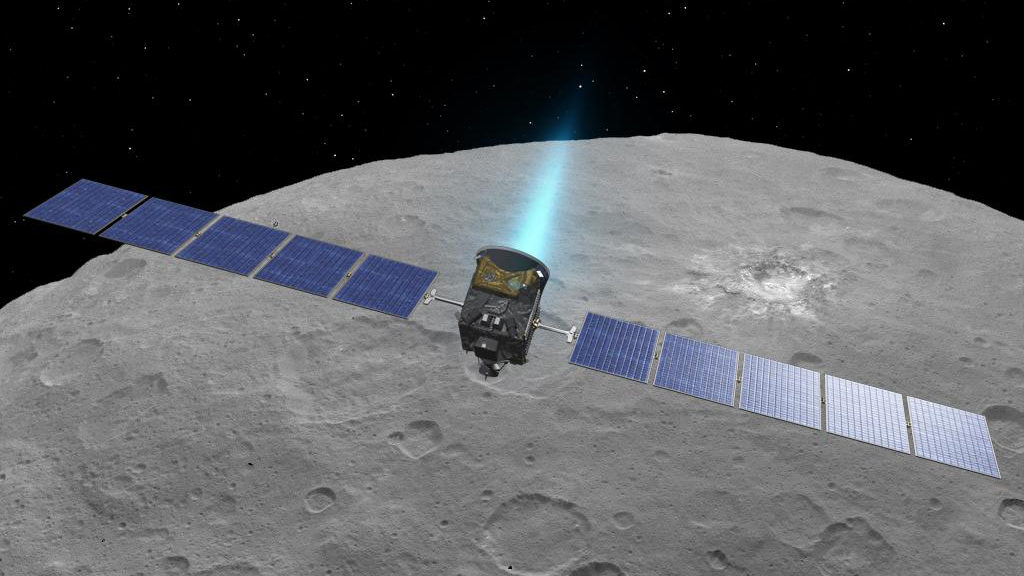This artist concept shows NASA's Dawn spacecraft above dwarf planet Ceres, as seen in images from the mission. Image Credit: NASA/JPL-Caltech