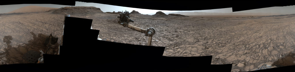"This 360-degree vista was acquired on Aug. 5, 2016, by the Mastcam on NASA's Curiosity Mars rover as the rover neared features called ""Murray Buttes"" on lower Mount Sharp. The dark, flat-topped mesa seen to the left of the rover's arm is about 50 feet high and, near the top, about 200 feet wide. Image Credit: NASA/JPL-Caltech/MSSS"