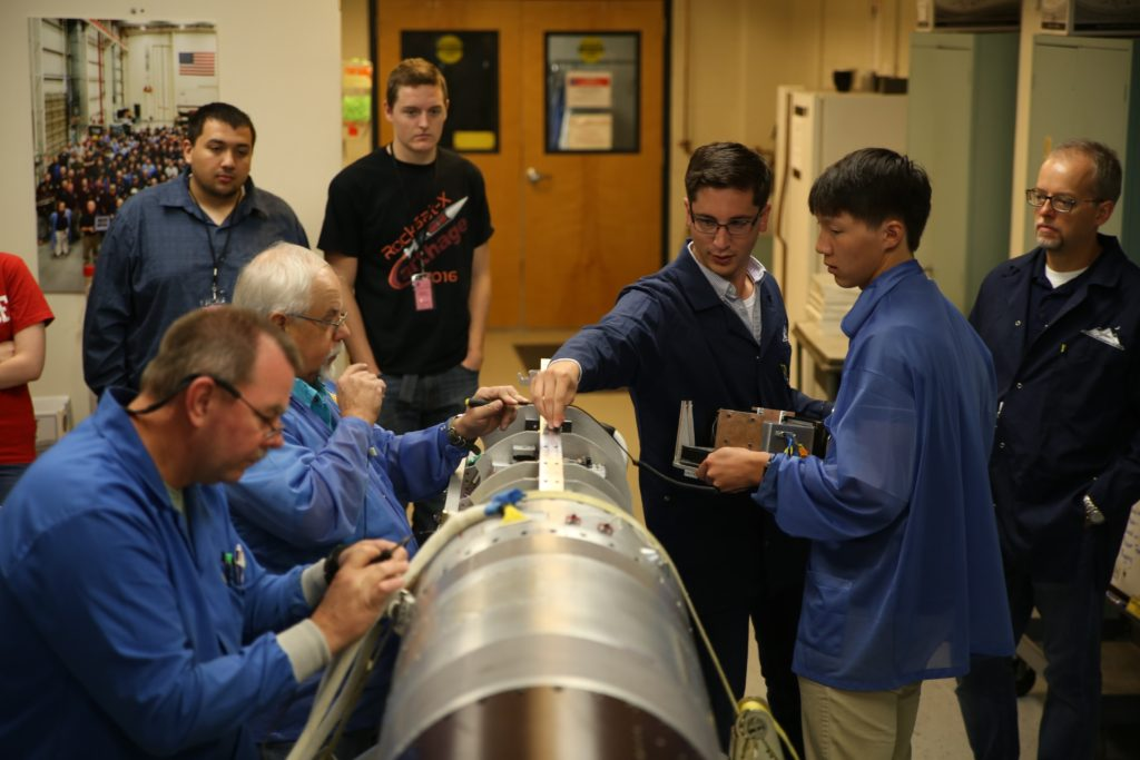 Nathaniel Lee, student from Carthage College, Kenosha, Wisconsin, receives final instructions before placing Cathage's experiment in the RockSat-X payload as part of final integration on Aug. 10 at Wallops. Image Credit: NASA/Berit Bland