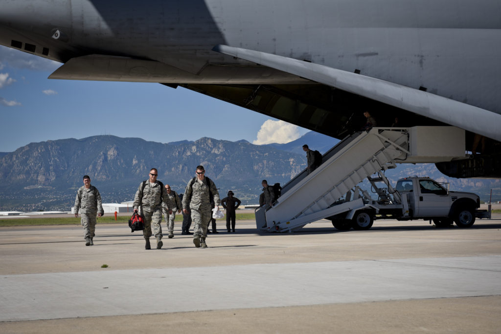 Airmen from the 4th Space Control Squadron disembark a C-5 Galaxy to greet their families at Peterson Air Force Base, Colo., Aug. 13, 2016. Spacecrews from the 21st Space Wing will be part of the Space Mission Task Force where Airmen perform operations from in garrison. Image Credit: U.S. Air Force/ Senior Airman Rose Gudex