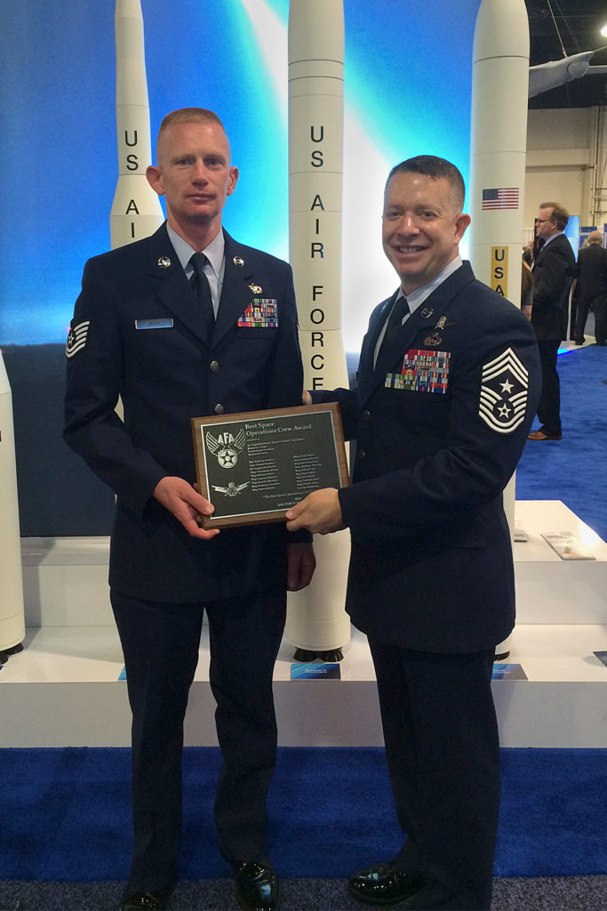 Tech. Sgt. William White, 4th Space Control Squadron, accepts the award for Air Force Space Crew of the Year, given by the Air Force Association during an awards ceremony in National Harbor, Md., Sept. 19, 2016. The award was accepted on behalf of deployed teammates. Image Credit: USAF
