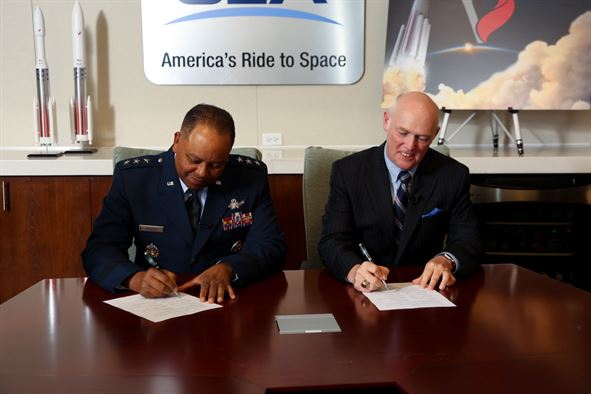 Lt. Gen. Samuel Greaves, Air Force program executive officer for Space and SMC commander, and Tory Bruno, ULA president and CEO, sign a Cooperative Research and Development Agreement or CRADA for the certification of ULA's Vulcan Launch System at a ceremony, Sept. 27. Image Credit: ULA
