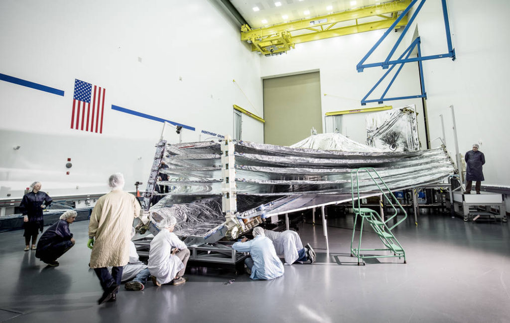NASA's Webb telescope sunshield, opened for inspection. In this photo, engineers and scientists examine the sunshield layers on this full-sized test unit. Image Credit: Northrop Grumman Corporation/Alex Evers