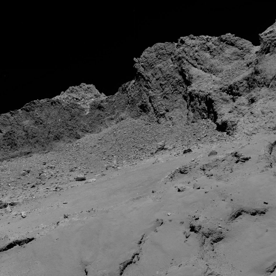 Rosetta's OSIRIS narrow-angle camera captured this image of Comet 67P/Churyumov-Gerasimenko at 01:20 GMT from an altitude of about 16 km above the surface during the spacecraft's final descent on 30 September. The image scale is about 30 cm/pixel and the image measures about 614 m across. Image Credit: ESA/Rosetta/MPS for OSIRIS Team MPS/UPD/LAM/IAA/SSO/INTA/UPM/DASP/IDA