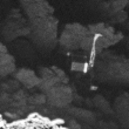 Close-up of the Philae lander, imaged by Rosetta's OSIRIS narrow-angle camera on 2 September 2016 from a distance of 2.7 km. The image scale is about 5 cm/pixel. Philae's 1 m-wide body and two of its three legs can be seen extended from the body. The images also provide proof of Philae's orientation. Image Credit: ESA/Rosetta/MPS for OSIRIS Team MPS/UPD/LAM/IAA/SSO/INTA/UPM/DASP/IDA
