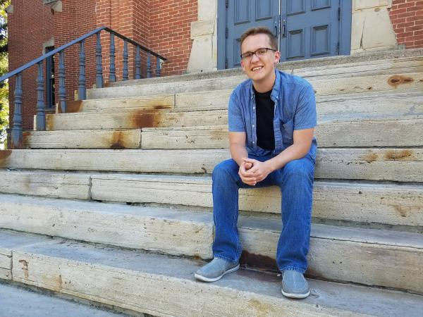 Austin Braun on the steps of Old Main. Image Credit: Kenna Bruner