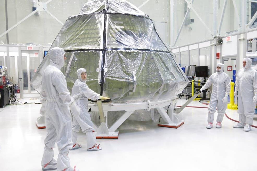 The Orion crew module for Exploration Mission 1 was transferred into the clean room inside the Neil Armstrong Operations and Checkout Building at Kennedy Space Center in late July to begin installation of the spacecraft's critical systems, including propellant lines.  Image Credit: NASA