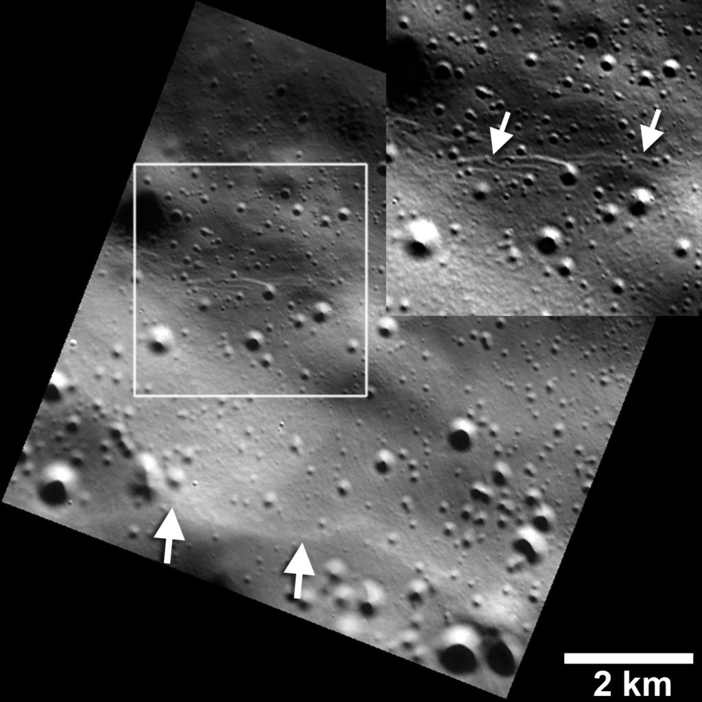 Small graben, or narrow linear troughs, have been found associated with small fault scarps (lower white arrows) on Mercury, and on Earth's moon. The small troughs, only tens of meters wide (inset box and upper white arrows), likely resulted from the bending of the crust as it was uplifted, and must be very young to survive continuous meteoroid bombardment. Image Credit: NASA/JHUAPL/Carnegie Institution of Washington/Smithsonian Institution