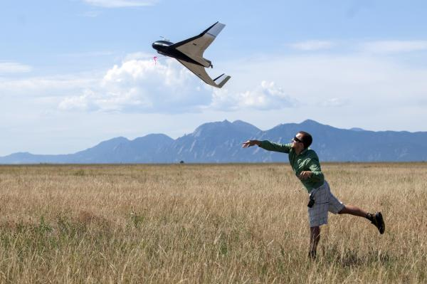 Aerospace Engineering graduate student Anthony Carfang launches a UAV for testing north of Boulder, Colorado. Image Credit: Glenn Asakawa / University of Colorado Boulder