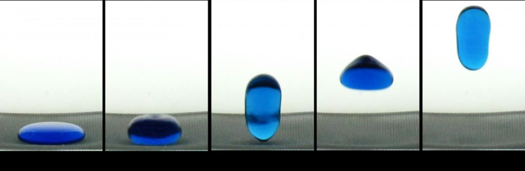 "A 2-mL ""puddle"" of water spontaneously jumps from a hydrophobic surface upon release into a free fall. Image Credit: Weislogel"