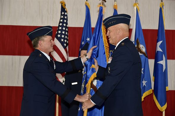 From left, Air Force Chief of Staff Gen. David L. Goldfein passes the guidon of Air Force Space Command, to Gen. John Raymond at Peterson Air Force Base, Colo., Oct. 25, 2016. Raymond was previously the Deputy Chief of Staff for Operations, Headquarters Air Force.. Image Credit: U.S. Air Force/Craig Denton