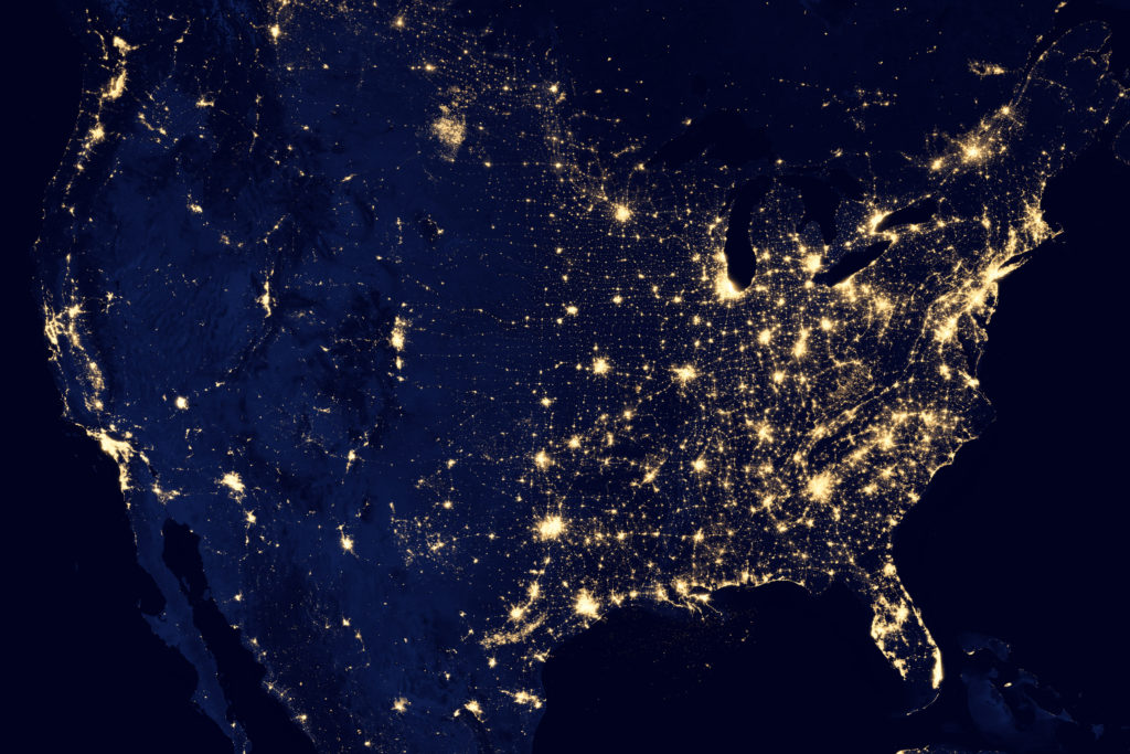 "This image of the continental United States at night is a composite assembled from data acquired by the Suomi NPP satellite in April and October 2012. The image was made possible by the satellite's ""day-night band"" of the Visible Infrared Imaging Radiometer Suite (VIIRS), which detects light in a range of wavelengths from green to near-infrared and uses filtering techniques to observe dim signals such as city lights, gas flares, auroras, wildfires and reflected moonlight. Image Credit: NASA Earth Observatory/NOAA NGDC"