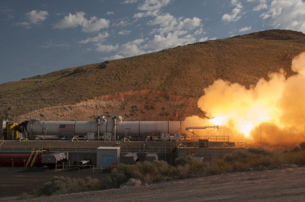 This Orbital ATK-manufactured, full-scale solid rocket booster qualification test motor blasted 3.6 million pounds of thrust during the two minute test in June. Two boosters will provide initial thrust to boost the SLS and Orion off the launch pad. Image Credit: Orbital ATK/Business Wire