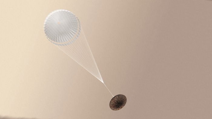 Artist impression of the Schiaparelli module after the parachute has been deployed. Image Credit: ESA/ATG medialab