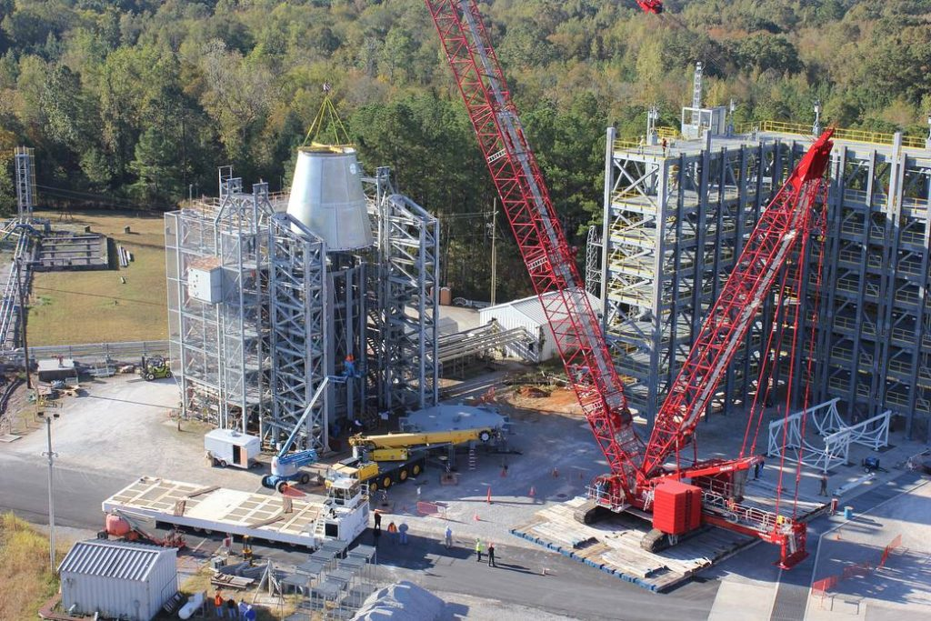 A test version of the launch vehicle stage adapter (LVSA) for NASA's Space Launch System rocket is loaded into the test stand at the agency's Marshall Space Flight Center in Huntsville, Alabama. Two simulators and four qualification articles of the upper part of the SLS will be stacked in the stand and subjected to forces similar to those experienced in flight. The LVSA joins the core stage simulator, which was loaded into the test stand Sept. 21. The other three qualification articles and the Orion simulator will complete the stack later this fall. Image Credit: NASA/MSFC/Brian Massey