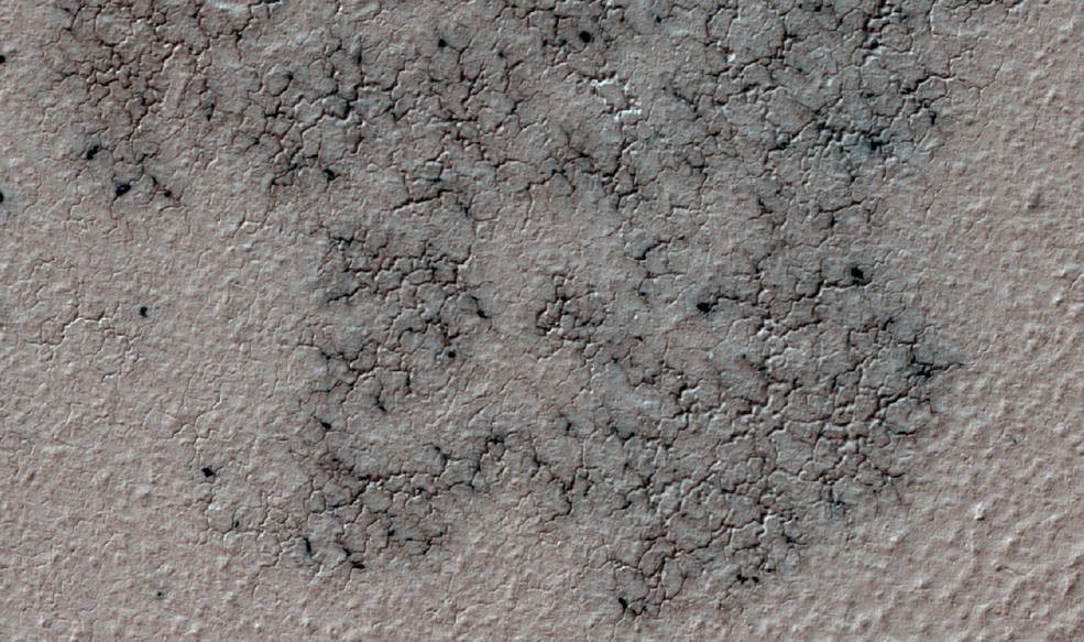 This image shows spidery channels eroded into Martian ground. It is a Sept. 12, 2016, example from HiRISE camera high-resolution observations of more than 20 places that were chosen in 2016 on the basis of about 10,000 volunteers' examination of Context Camera lower-resolution views of larger areas. Image Credit: NASA/JPL-Caltech/Univ. of Arizona