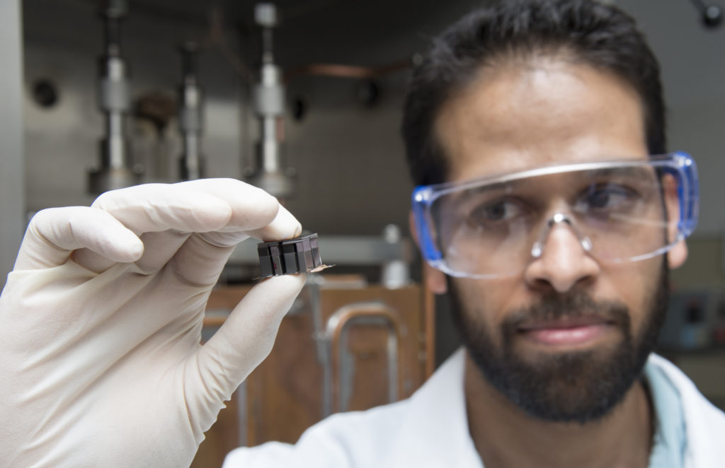 Samad Firdosy, a materials engineer at JPL, holds a thermoelectric module made of four thermocouples, which are devices that help turn heat into electricity. Thermocouples are used in household heating applications, as well as power systems for spacecraft. Image Credit: NASA/JPL-Caltech