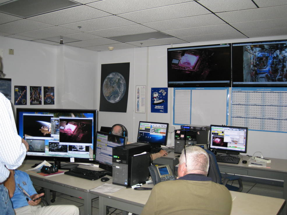 Veggie team members in monitor Veg-03 activation aboard the International Space Station via a live video downlink to the Experiment Monitoring Area located in Space Station Processing Facility at NASA's Kennedy Space Center in Florida. Image Credit: NASA
