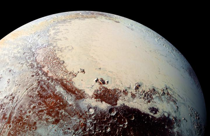"Sputnik Planitia (the left lobe of Pluto's ""heart"") is believed to be the outer solar system equivalent of a lunar ""mascon"" (mass concentration). Like mascons on the Moon, Sputnik Planitia is believed to be an impact basin, filled in with lavas (on Pluto, cryogenic ices take the place of lavas). Image Credit: NASA/Johns Hopkins University Applied Physics Laboratory/Southwest Research Institute"