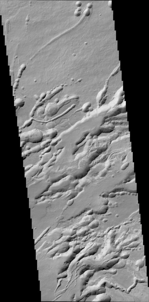 A structure called Arsia Chasmata on the flanks of one of the large volcanoes, Arsia Mons. The width of the image is around 25 km. The formation is volcanic in origin and pit craters (possibly caused by subsidence) can be seen. Image Credit: ESA/Roscosmos/ExoMars/CaSSIS/UniBE