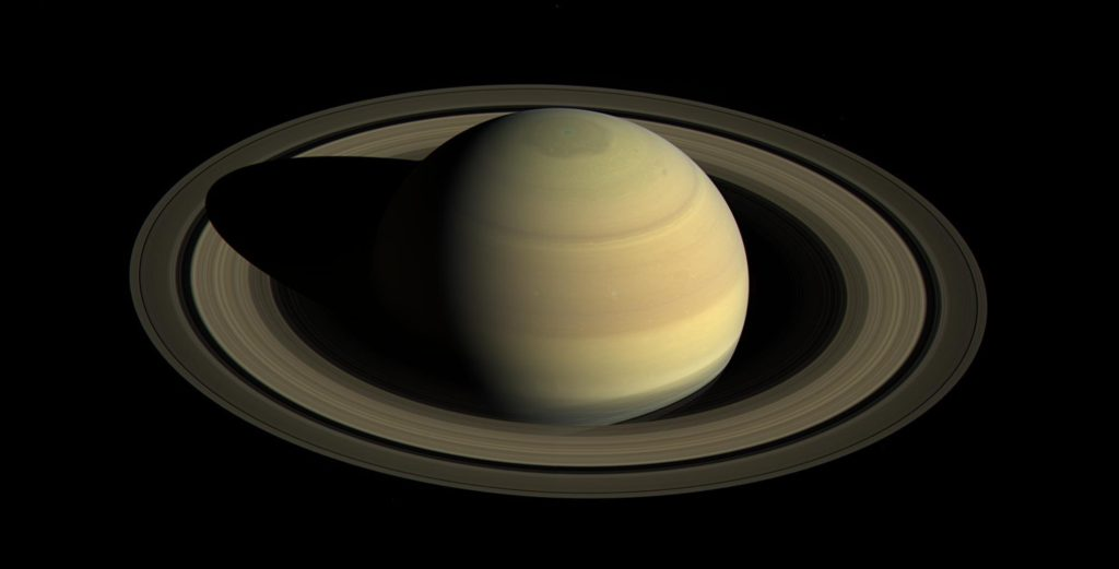 Cassini will soon begin a series of 20 orbits that fly high above and below Saturn's poles, plunging just past the outer edge of the main rings. Image credit: NASA/JPL-Caltech/Space Science Institute