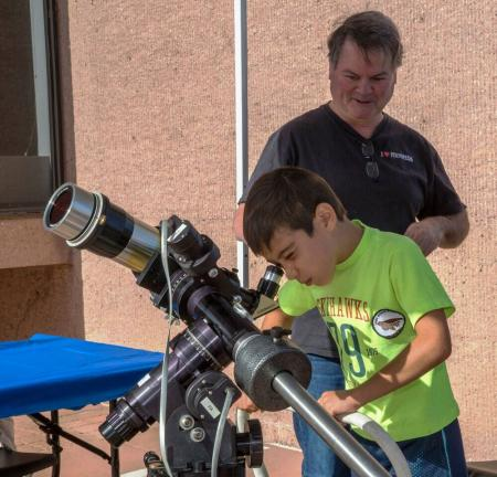 Dennis Gallagher guides young participant in using the sun viewing telescope. Image Credit: HAO
