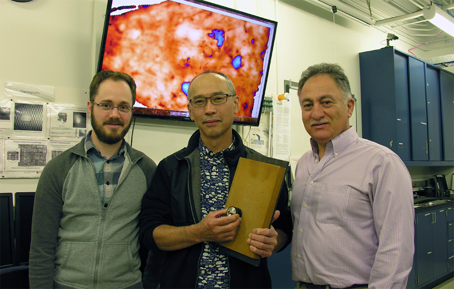 From left, Dr. Toby Case, Dr. Yong Kim, and Dr. Shant Kenderian, of the Space Materials Laboratory, developed a nondestructive technique for examining the bond quality on the Orion heat shield. Here they are shown with the ultrasonic transducer and a sample of the heat-shield material; the monitor behind them shows the type of imagery produced by the technique. Image Credit: The Aerospace Corporation/Jasen Ross
