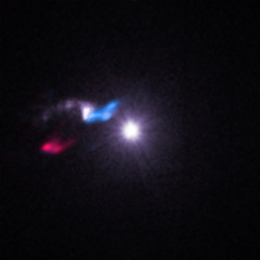 "This composite image shows X-rays from NASA's Chandra X-ray Observatory (white) and radio data from the Smithsonian's Submillimeter Array (red and blue). The X-ray data reveal a bright X-ray source to the right known as Cygnus X-3, a system containing either a black hole or neutron star (a.k.a. a compact source) left behind after the death of a massive star. Within that bright source, the compact object is pulling material away from a massive companion star. Astronomers call such systems ""X-ray binaries."" Image Credit: X-ray: NASA/CXC/SAO/M.McCollough et al, Radio: ASIAA/SAO/SMA"