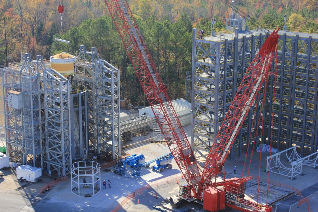 A test version of the interim cryogenic propulsion stage (ICPS) for NASA's Space Launch System rocket is loaded into the test stand at the agency's Marshall Space Flight Center in Huntsville, Alabama. Two simulators and four qualification articles of the upper part of the SLS will be stacked in the stand and subjected to forces similar to those experienced in flight. The ICPS joins the core stage simulator and launch vehicle stage adapter, which were loaded into the test stand earlier this fall. Image Credit: NASA/MSFC/Brian C. Massey