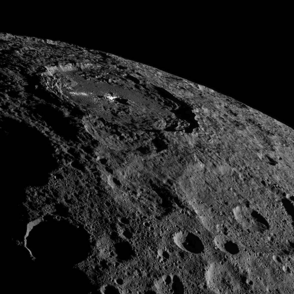 Occator Crater, home of Ceres' intriguing brightest areas, is prominently featured in this image from NASA's Dawn spacecraft. Image Credit: NASA/JPL-Caltech/UCLA/MPS/DLR/IDA