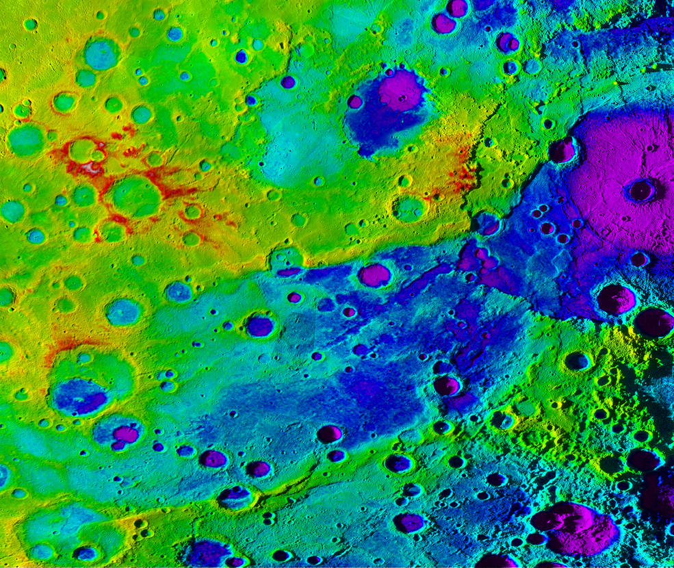 "Using colorized topography, Mercury's ""great valley"" (dark blue) and Rembrandt impact basin (purple, upper right) are revealed in this high-resolution digital elevation model merged with an image mosaic obtained by NASA's MESSENGER spacecraft. Image Credit: NASA/JHUAPL/Carnegie Institution of Washington/DLR/Smithsonian Institution"