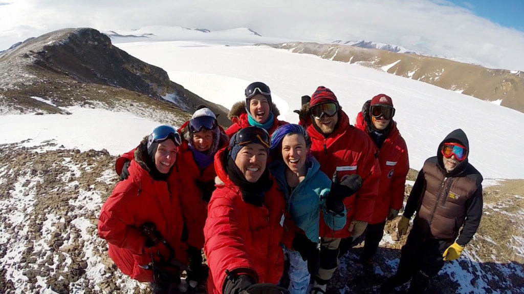 ANSMET team members break for a selfie atop a peak in the Miller Range, Antarctica. The team searches for meteorites in the harsh environment of Earth's southernmost continent on foot and on snowmobiles. Image Credit: Constantine Tsang