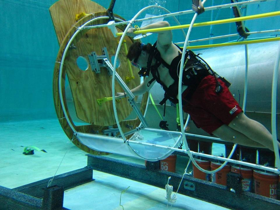 The University of Maryland's human factors evaluation of airlock sizing at the University of Maryland neutral buoyancy tank. Image Credit: University of Maryland